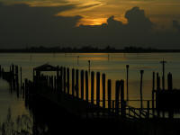 Sunset over the river at the dock in Sebasstian Florida